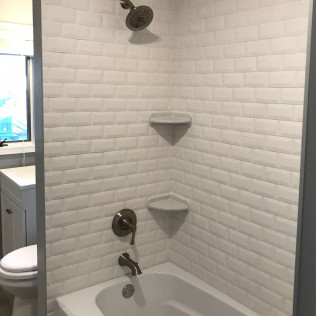 shower remodeling job - white brick with inlaid shelves
